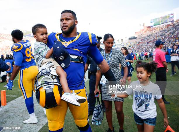 Defensive tackle Aaron Donald of the Los Angeles Rams joins his family after the Rams' win against the Green Bay Packers at Los Angeles Memorial...