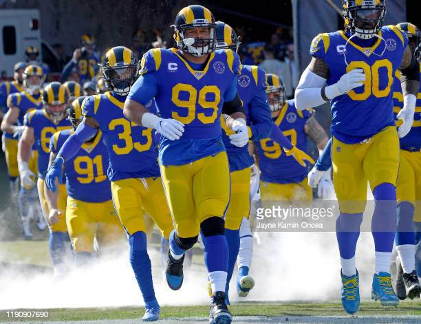 Defensive tackle Aaron Donald of the Los Angeles Rams leads the team on to the field for the game against the Arizona Cardinals at the Los Angeles...