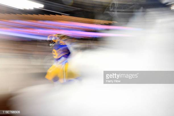Defensive tackle Aaron Donald of the Los Angeles Rams runs on to the field before the game against the Seattle Seahawks at Los Angeles Memorial...