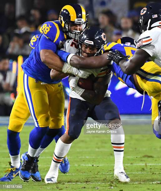 Defensive tackle Aaron Donald of the Los Angeles Rams stops running back David Montgomery of the Chicago Bears in the second half of the game at the...