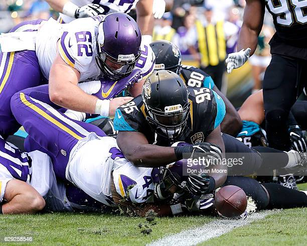 Defensive Tackle Abry Jones of the Jacksonville Jaguars forces a fumble on Runningback Matt Asiata of the Minnesota Vikings during the game at...