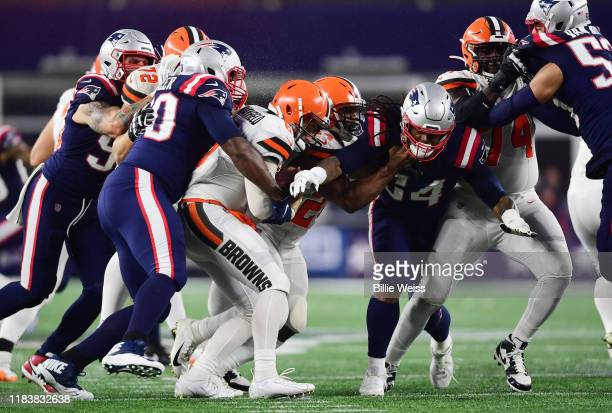 Defensive tackle Adam Butler of the New England Patriots sacks quarterback Baker Mayfield of the Cleveland Browns of the game at Gillette Stadium on...
