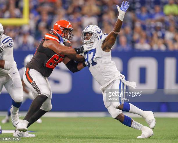 Defensive tackle AlQuadin Muhammad of the Indianapolis Colts makes the move on offensive tackle Brad Seaton of the Cleveland Browns at Lucas Oil...