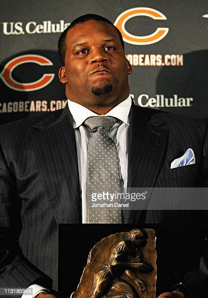 Defensive tackle Anthony Adams of the Chicago Bears poses with his award during the 2010 Brian Piccolo Award ceremony at Halas Hall on April 26 2011...