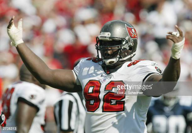 Defensive tackle Anthony McFarland of the Tampa Bay Buccaneers celebrates during the NFL game against the Dallas Cowboys at Raymond James Stadium on...