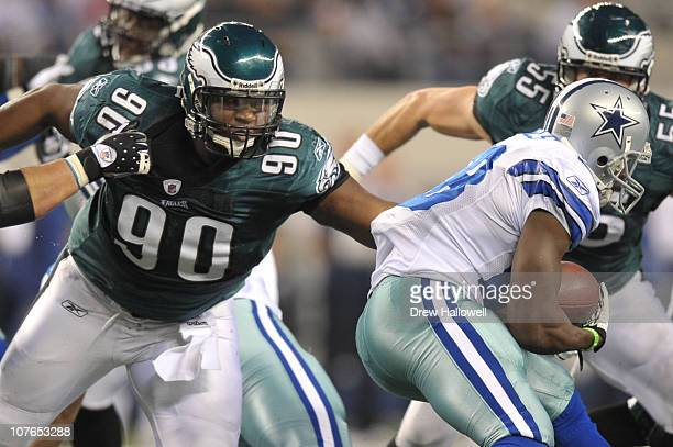 Defensive tackle Antonio Dixon of the Philadelphia Eagles moves to tackle running back Felix Jones of the Dallas Cowboys during the game at Cowboys...