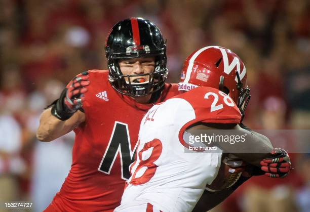 Defensive tackle Baker Steinkuhler of the Nebraska Cornhuskers zeros in on running back Montee Ball of the Wisconsin Badgers during their game at...