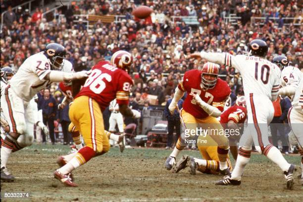 Defensive tackle Bill Brundige of the Washington Redskins presures quarterback Bobby Douglass of the Chicago Bears as he passes the ball during an...