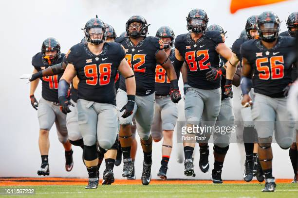 Defensive tackle Brendon Evers, defensive tackle Cameron Murray, defensive end Cole Walterscheid, and offensive lineman Larry Williams of the...
