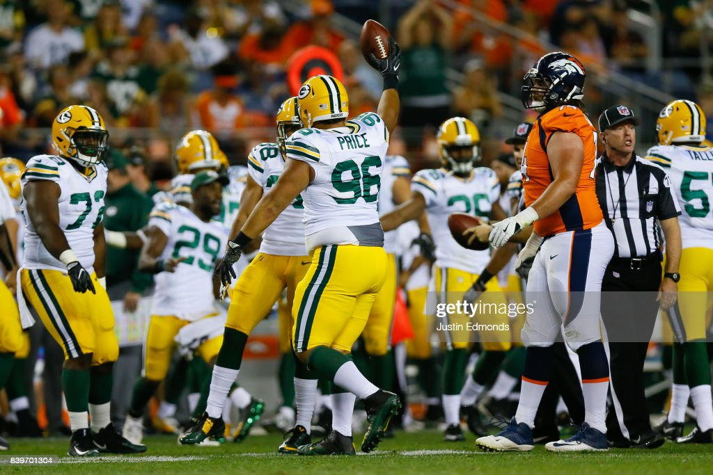 Defensive tackle Brian Price #96 of the Green Bay Packers celebrates after recovering a fumble by running back De'Angelo Henderson of the Denver Broncos in the fourth quarterof a Preseason game at Sports Authority Field at Mile High on August 26, 2017 in Denver, Colorado. The Broncos defeated the Packers 20-17.