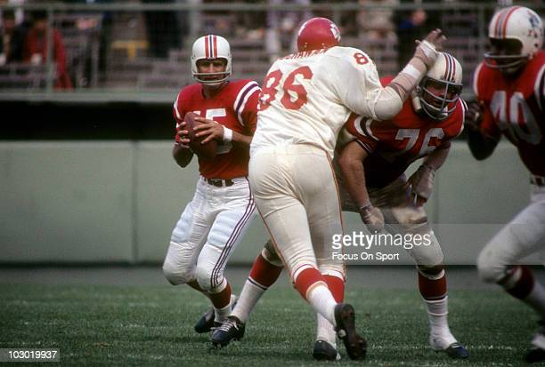 Defensive Tackle Buck Buchanan of the Kansas City Chiefs tries to get pass gurard Charley Long to get to quarterback Babe Parilli of the Boston...