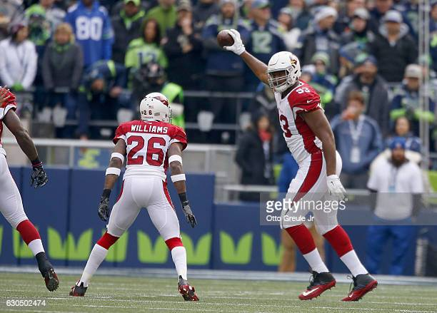 Defensive tackle Calais Campbell of the Arizona Cardinals recovers a fumble by the Seattle Seahawks at CenturyLink Field on December 24 2016 in...