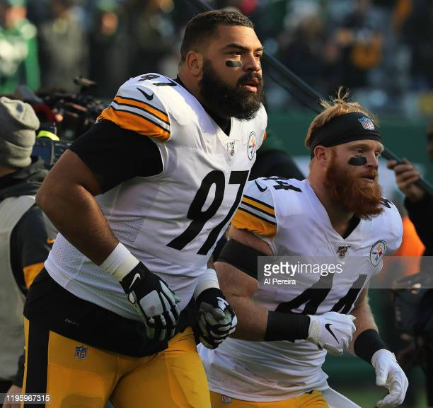 Defensive Tackle Cameron Heyward and Linebacker Tyler Matakevich of the Pittsburgh Steelers take to the field against the New York Jets in the first...