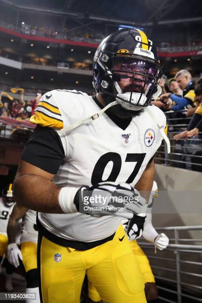 Defensive tackle Cameron Heyward of the Pittsburgh Steelers runs onto the field during the NFL game against the Arizona Cardinals at State Farm...