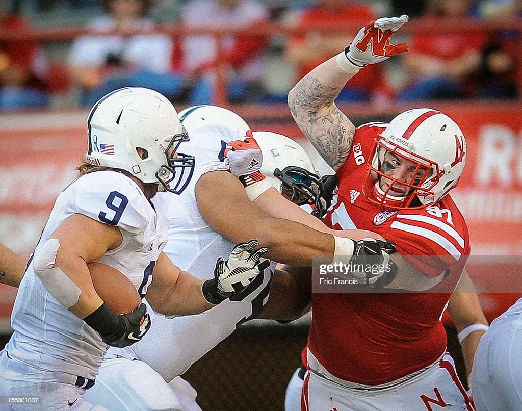 Defensive tackle Chase Rome #97 of the Nebraska Cornhuskers fights his way to running back Michael Zordich #9 of the Penn State Nittany Lions during their game at Memorial Stadium on November 10, 2012 in Lincoln, Nebraska.
