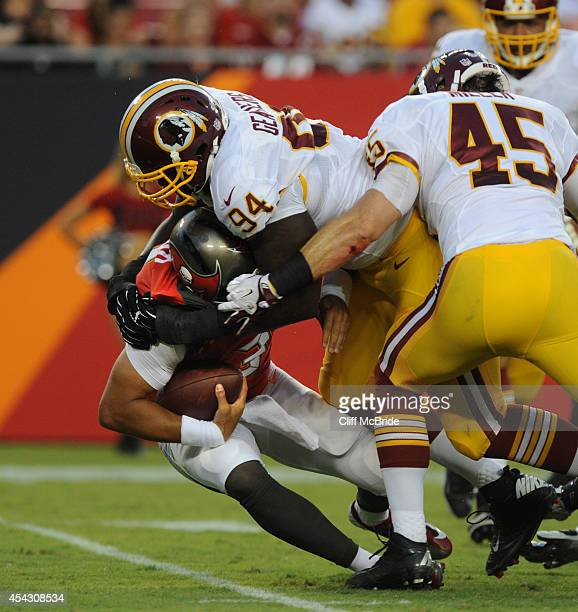 Defensive tackle Clifton Geathers of the Washington Redskins sacks quarterback Mike Kafka of the Tampa Bay Buccaneers at Raymond James Stadium on...