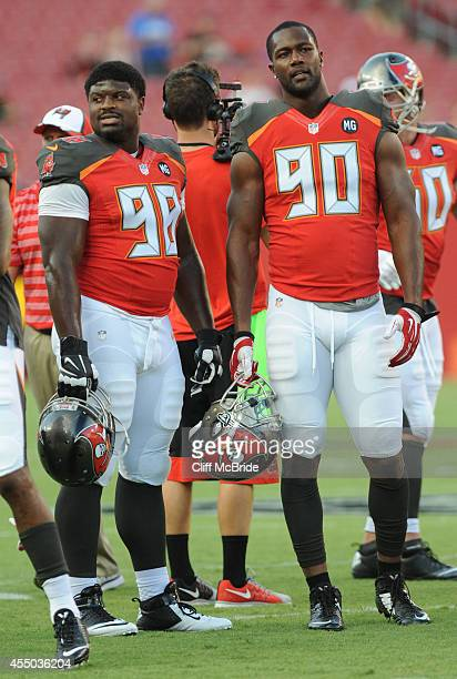 Defensive tackle Clinton McDonald and defensive end Michael Johnson of the Tampa Bay Buccaneers in pregame before their preseason game with the...
