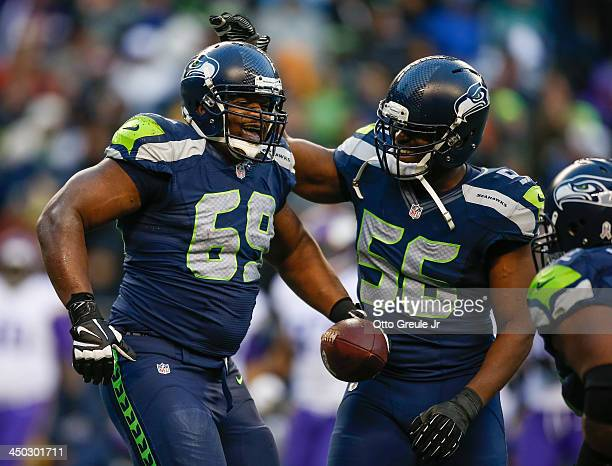 Defensive tackle Clinton McDonald of the Seattle Seahawks is congratulated by defensive end Cliff Avril after making an interception against the...