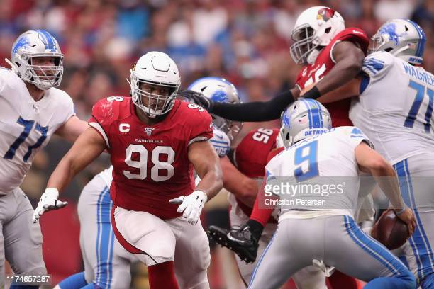 Defensive tackle Corey Peters of the Arizona Cardinals chases quarterback Matthew Stafford of the Detroit Lions during the first half of the NFL game...