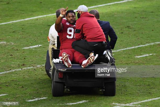 Defensive tackle Corey Peters of the Arizona Cardinals is carted off the field during the first half against the Buffalo Bills at State Farm Stadium...