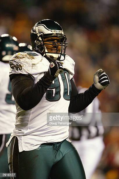 Defensive tackle Corey Simon of the Philadelphia Eagles reacts on the field during the game against the Washington Redskins on December 27 2003 at...