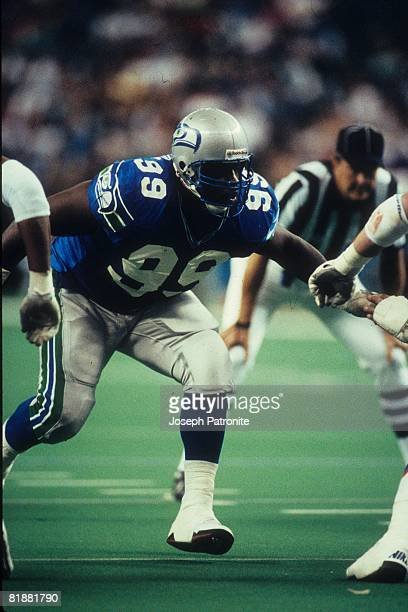 Defensive tackle Cortez Kennedy of the Seattle Seahawks runs in pursuit against the Denver Broncos at the Kingdome in Seattle Washington on November...