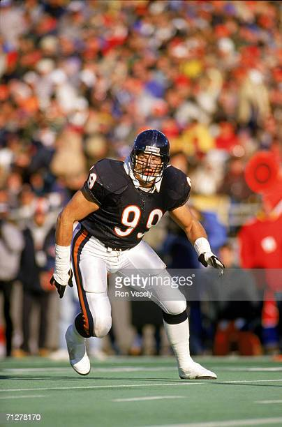 Defensive tackle Dan Hampton of the Chicago Bears plays defense in an undated photo during a game at Soldier Field in Chicago Illinois Hampton played...