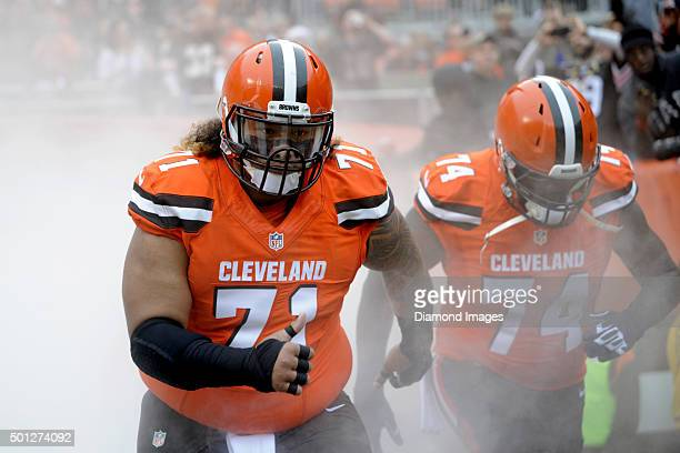 Defensive tackle Danny Shelton and offensive lineman Cameron Erving of the Cleveland Browns run onto the field prior to a game against the San...