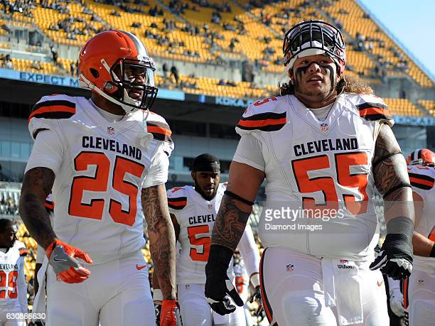 Defensive tackle Danny Shelton and running back George Atkinson III of the Cleveland Browns talk as they walk off the field prior to a game against...
