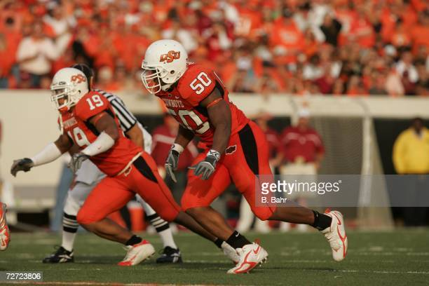 Defensive tackle Darnell Smith and linebacker Jeremy Nethon of the Oklahoma State Cowboys rush against the Oklahoma Sooners on November 25 2006 at...