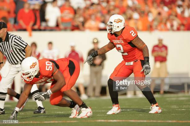 Defensive tackle Darnell Smith and linebacker Rodrick Johnson of the Oklahoma State Cowboys prepares for a snap against the Oklahoma Sooners on...