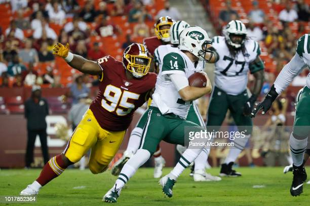 Defensive tackle Da'Ron Payne of the Washington Redskins sacks quarterback Sam Darnold of the New York Jets in the first quarter of a preseason game...