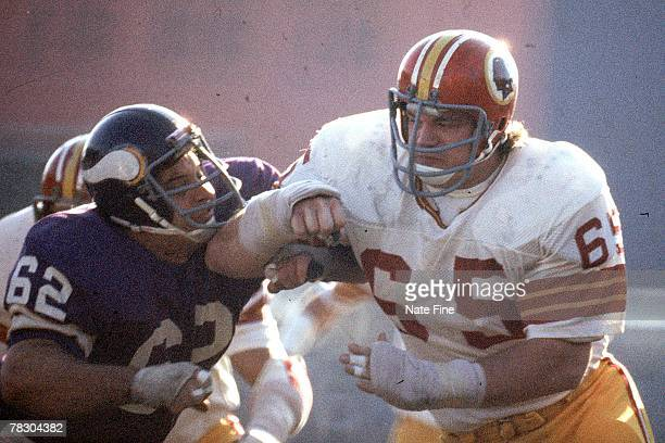 Defensive tackle Dave Butz of the Washington Redskins takes on center Ed White of the Minnesota Vikings in the 1976 NFC Championship Game on December...