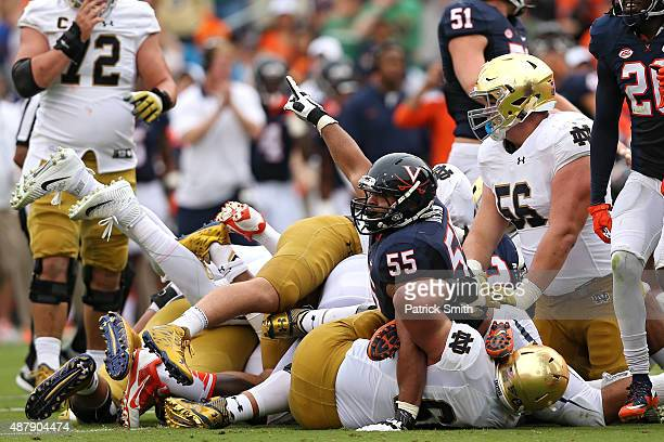 Defensive tackle David Dean of the Virginia Cavaliers celebrates a fourth down turnover on downs against the Notre Dame Fighting Irish in the second...