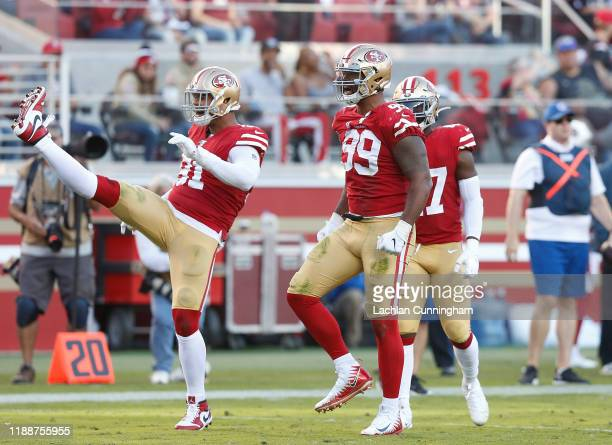 Defensive tackle DeForest Buckner and defensive end Arik Armstead of the San Francisco 49ers reacts after making a defensive stop in the third...
