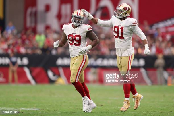 Defensive tackle DeForest Buckner and defensive end Arik Armstead of the San Francisco 49ers react after a defensive stop during the second half of...