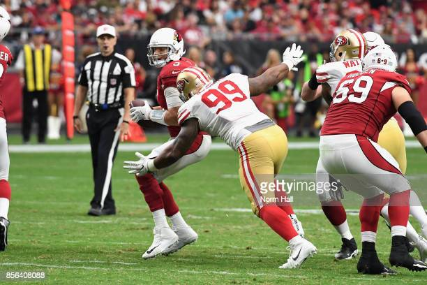 Defensive tackle DeForest Buckner of the San Francisco 49ers hits quarterback Carson Palmer of the Arizona Cardinals during the second half of the...