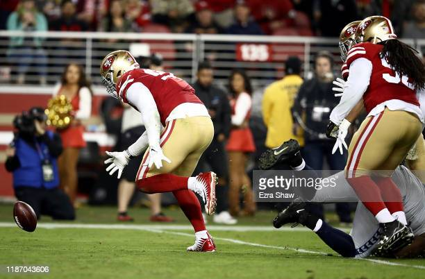 Defensive tackle DeForest Buckner of the San Francisco 49ers recovers a fumble for a touchdown over the Seattle Seahawks in the fourth quarter of the...