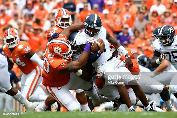Defensive tackle Dexter Lawrence of the Clemson Tigers leads a tackle on quarterback Shai Werts of the Georgia Southern Eagles during the football...