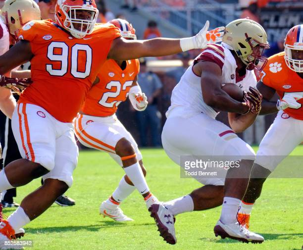 Defensive tackle Dexter Lawrence of the Clemson Tigers tries to grab running back AJ Dillon of the Boston College Eagles at Memorial Stadium on...