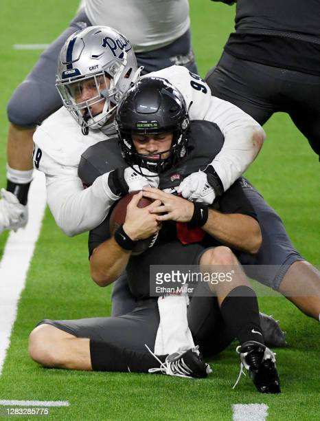 Defensive tackle Dom Peterson of the Nevada Wolf Pack sacks quarterback Max Gilliam of the UNLV Rebels in the second half of their game at Allegiant...
