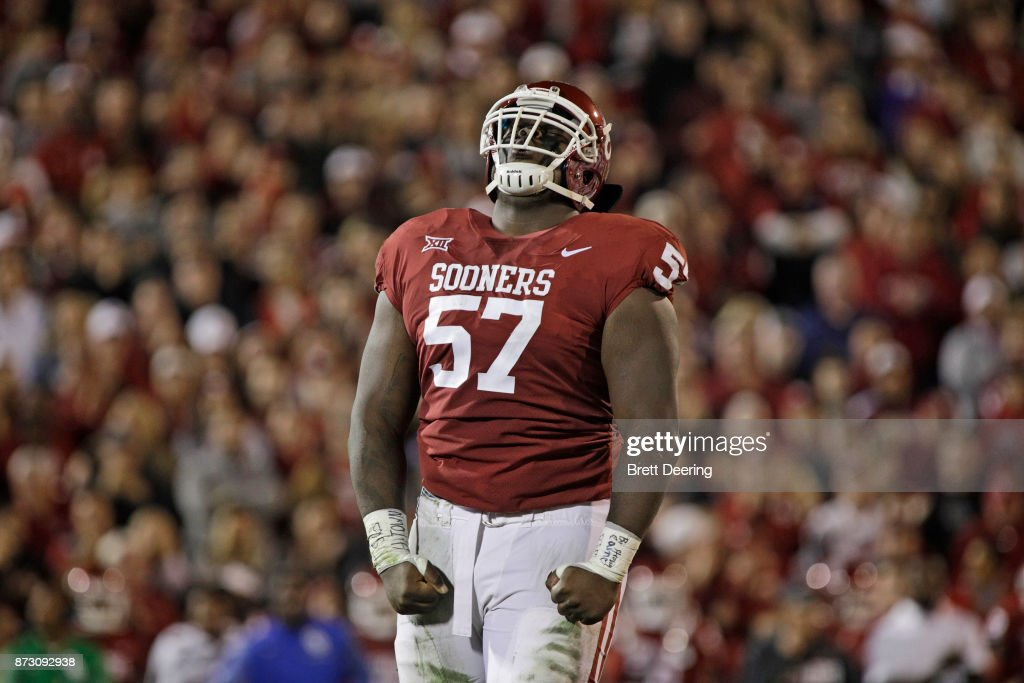 Defensive tackle Du'Vonta Lampkin #57 of the Oklahoma Sooners celebrates a defensive stop against the TCU Horned Frogs at Gaylord Family Oklahoma Memorial Stadium on November 11, 2017 in Norman, Oklahoma. Oklahoma defeated TCU