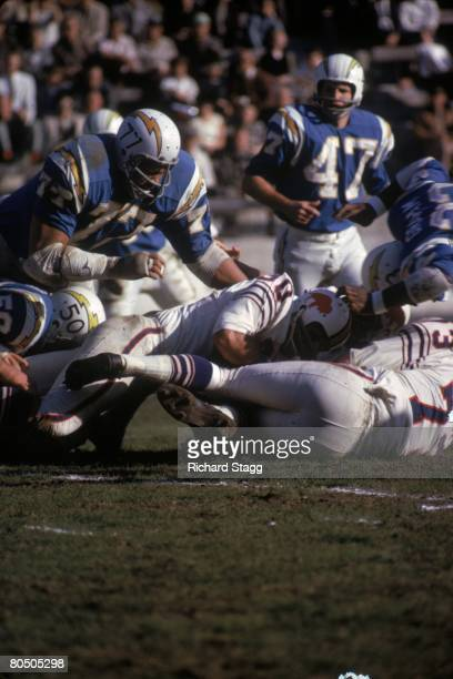 Defensive tackle Ernie Ladd of the San Diego Chargers leaps in to assist on a tackle on fullback Wray Carlton of the Buffalo Bills at Balboa Stadium...