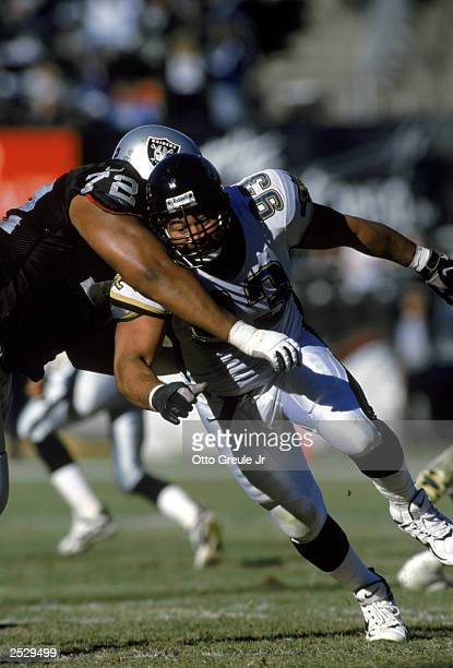 Defensive tackle Esera Tuaolo of the Jacksonville Jaguars attempts to move through Lincoln Kennedy of the Oakland Raiders on December 2, 1997 during...