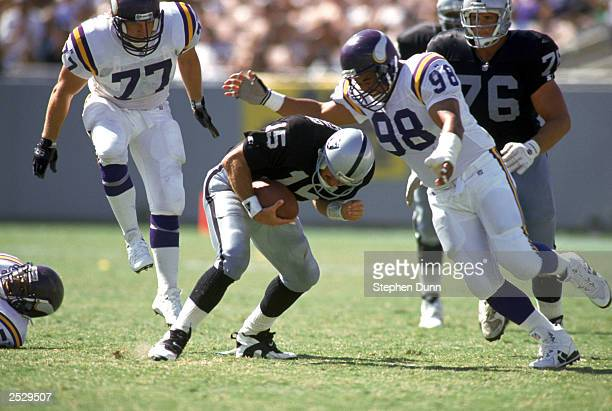 Defensive tackle Esera Tuaolo of the Minnesota Vikings moves to stop quarterback Jeff Hostetler of the LA Raiders on September 5 1993 during the NFL...