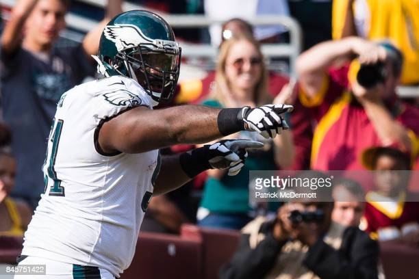 Defensive tackle Fletcher Cox of the Philadelphia Eagles celebrates after recovering a fumble and returning it for a touchdown in the fourth quarter...