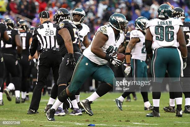 Defensive tackle Fletcher Cox of the Philadelphia Eagles reacts after recovering a fumble in the second quarter against the Baltimore Ravens at MT...