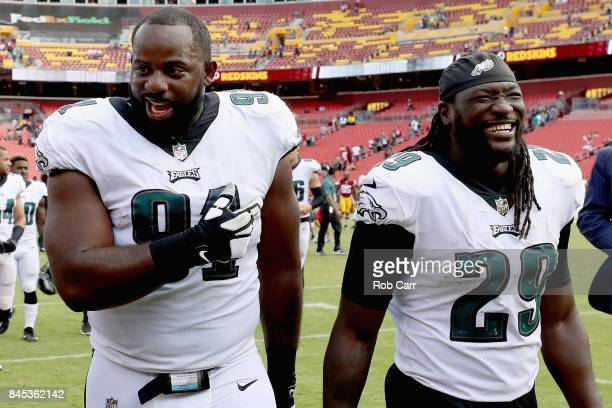 Defensive tackle Fletcher Cox of the Philadelphia Eagles walks off the field with LeGarrette Blount after the Eagles defeated the Washington Redskins...