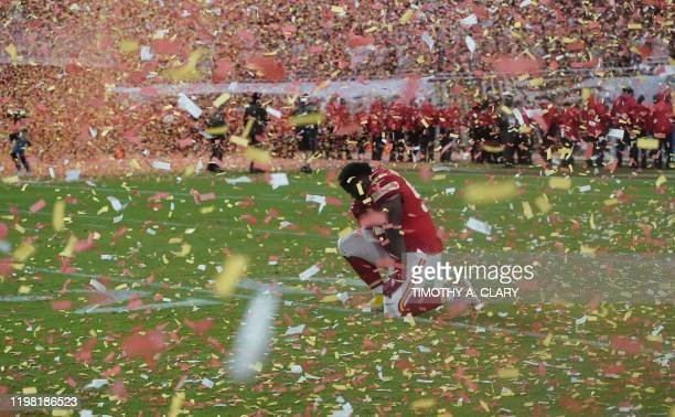Defensive Tackle for the Kansas City Chiefs Xavier Williams kneels on the field after winning Super Bowl LIV between the Kansas City Chiefs and the...