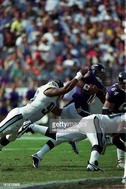 Defensive Tackle Gary Walker of the Jacksonville Jaguars tries to sack Quarterback Tony Banks of the Baltimore Ravens during an NFL game at the...